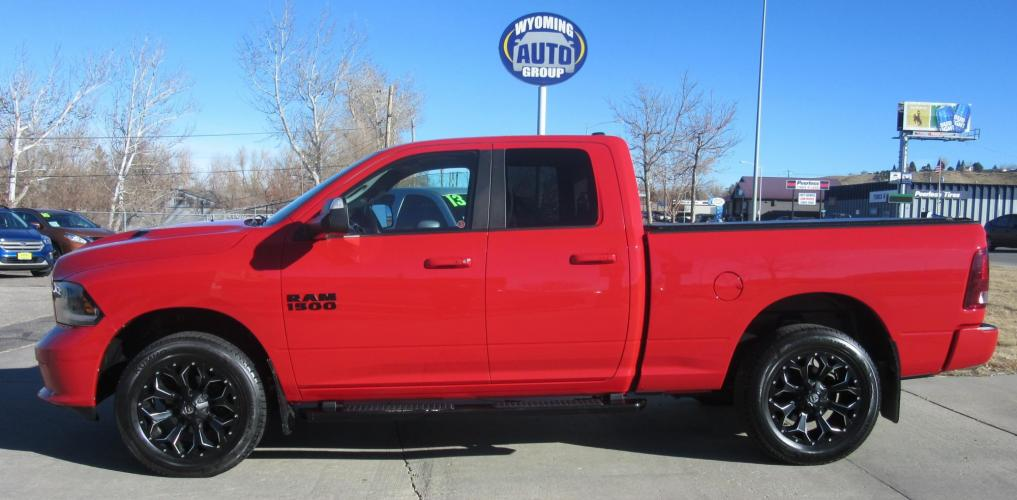 2015 RAM 1500 Sport Quad Cab 4WD (1C6RR7HTXFS) with an 5.7L V8 OHV 16V engine, 6-Speed Automatic transmission, located at 3030 CY Ave, Casper, WY, 82604, (307) 265-3830, 42.827816, -106.357483 - Photo #0
